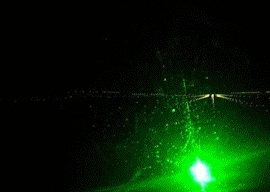 What the pilot sees: a (simulated) runway obscured by a laser flash
