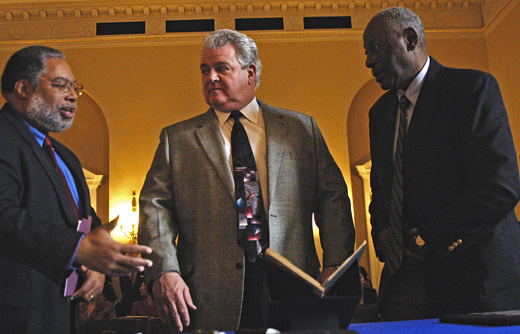 From left, Lonnie Bunch, director of the National Museum of African AMerican History and Culture; Rep. Robert A. Brady (D-Pa.), chair of the Comitte on House Administration; and Charles L. Blockson, a Philadelphia historian, discuss a book of hymnals that once belonged to Harriet Tubman. The book is one of 39 items donated to the museum by Blockson.