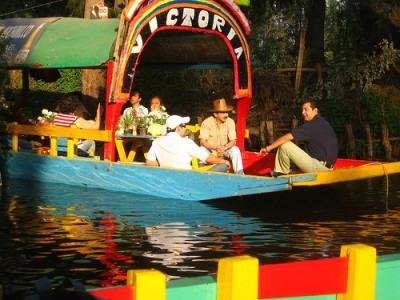 Dining on the water in Xochimilco, Mexico. Courtesy of Flickr user Owen Prior