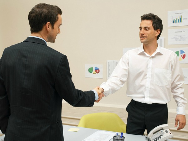 guys shaking hands after negotiation