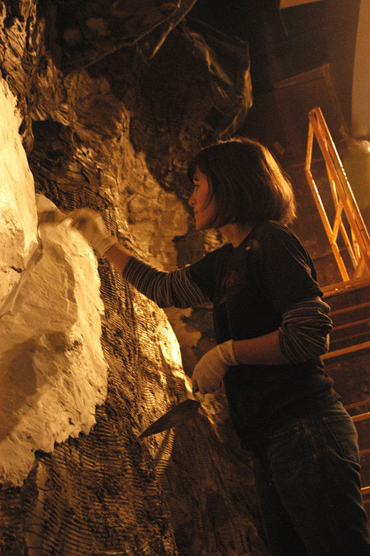 A member of the crew at the Natural History Museum works on the cave vignette in the David A. Koch Hall of Human Origins, a new exhibit scheduled to open March 17.
