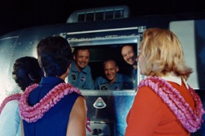 The Apollo 11 crewmembers are greeted by their wives in Houston.