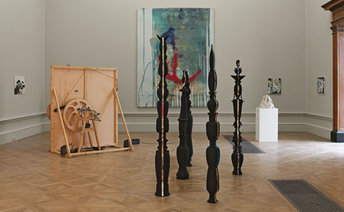 The installation of five totem poles by artist Tatiana Echeverri Fernandez. One of the totems was recently destroyed by a visitor at the Royal Academy.