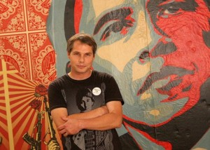 "Shepard Fairey with his ""Hope"" portrait, Courtesy of Jill Greenberg"