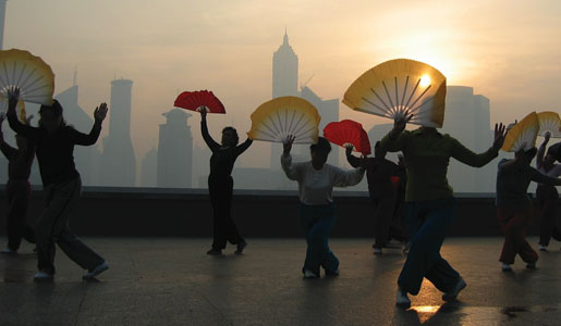 Traditional fan dance exercise at dawn on the Bund in Shanghai. Photo: Genevieve Bergendahl