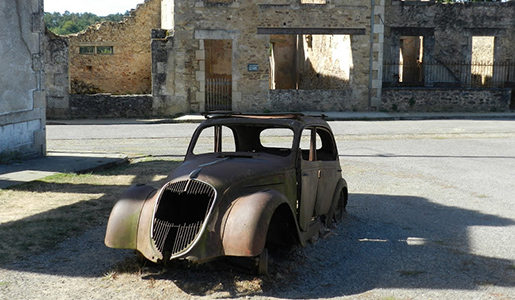 Burned out car, left by Germans at Oradour-sur-Glane. Photo courtesy of John Sweets.