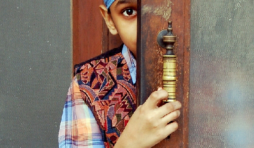 A Sikh boy gazes outwards with curiosity in Amritsar, India.  Photograph by Murray Stanford