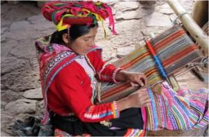 Woman weaving alpaca wool.