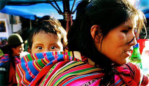 Peruvian woman carrying her child in traditional style. Photo by Aaron O'dea