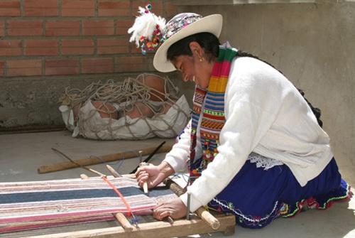 A Peruvian woman weaving, Photo by Carmen-Julia Arze