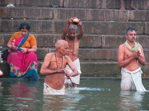 Practicing Surya Pranam at the Ganges in Varanasi.