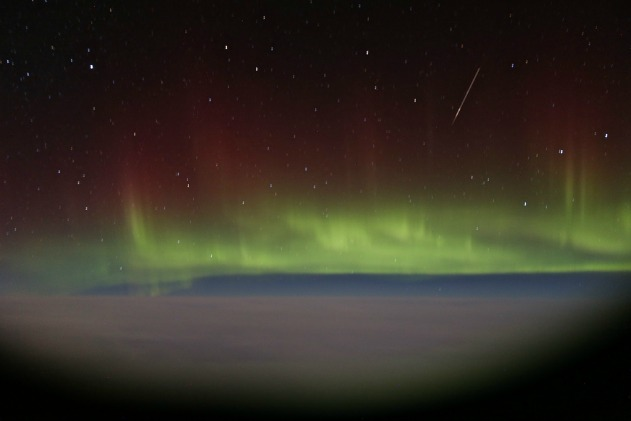 Northern Lights Seen From Airplane with a Meteor