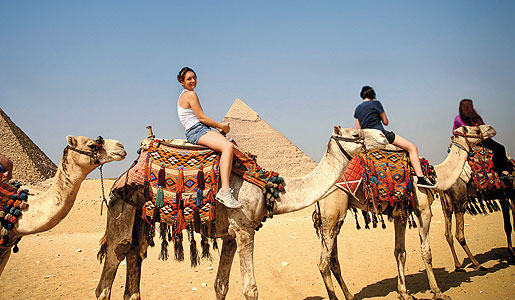 Enjoy riding camels with the whole family!