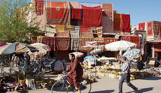 Moroccan textiles to be sold at a town market.
