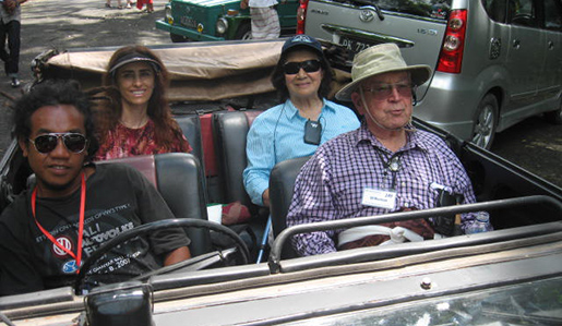 Smithsonian travelers enjoy an open-air ride around town