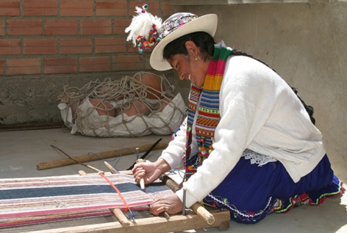 A Peruvian woman weaving, Photo by Carmen-Julia Arze