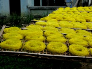 Saffron noodles drying in the sun. Photo: Stan Shapiro
